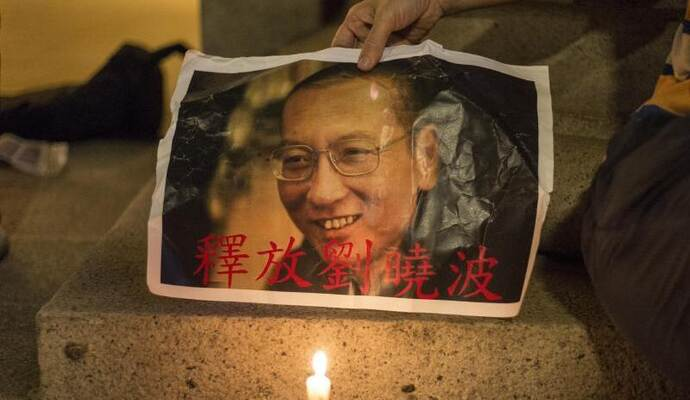 Trauer um den verstorbenen Friedensnobelpreisträger Liu Xiaobo in Hongkong. Foto: Chan Long Hei, Pacific Press via ZUMA